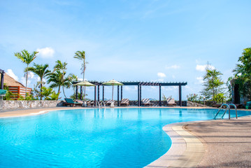 landscape swimming pool blue sky with clouds. Tropical beautiful hotel in thailand.