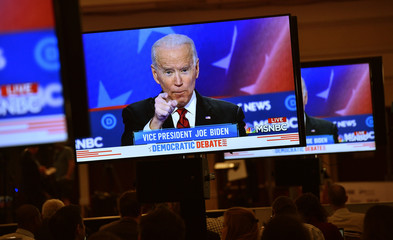 Former Vice President Joe Biden is seen speaking on a live video feed in the media filing center during the ninth Democratic 2020 U.S. Presidential candidates debate at the Paris Theater in Las Vegas