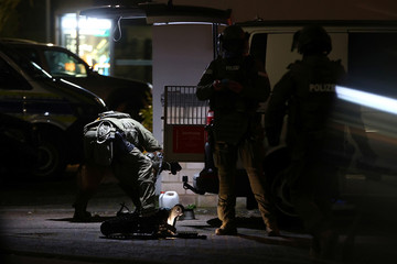 German special forces prepare to search an area after a shooting in Hanau near Frankfurt