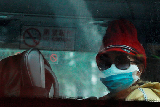 A passenger from the cruise ship Diamond Princess arrives at a newly-built public housing Chun Yeung Estate for quarantine, following the outbreak of the new coronavirus, at Fo Tan in Hong Kong