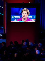 Audience members watch a television monitor displaying an image of Senator Elizabeth Warren at the ninth Democratic 2020 U.S. Presidential candidates debate at the Paris Theater in Las Vegas