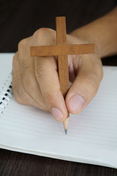 Surreal image of wooden cross pencil