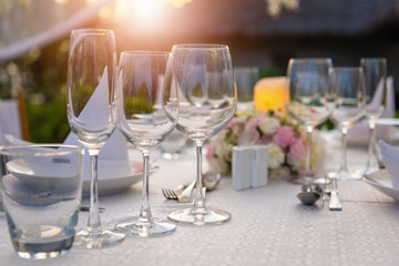 Romantic dinner setting with sunset