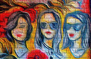 Street art.  Visages de trois femmes sur un mur de briques recouvert de ciment