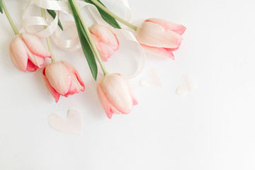Fotorolgordijn Tulp Hello spring. Pink tulips with ribbon and hearts on white background, flat lay. Stylish soft spring image. Happy womens day. Greeting card mockup with space for text. Happy Mothers day.