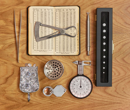 Collection of Jewellery Tools for Diamond Grading with Antique Book and Loose Diamonds