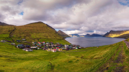 Wall Mural - Panorama of mountains and ocean around village of Funningur on Faroe Islands