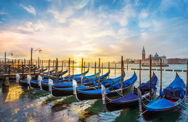 Wall Mural - Landscape with  Gondolas and San Giorgio Maggiore church in Venice at sunrise, Italy