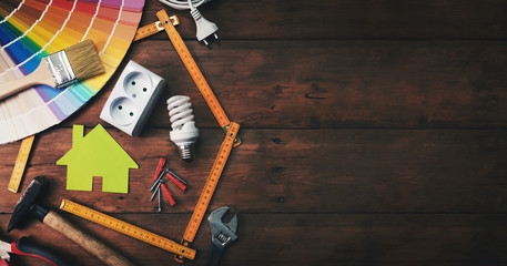 home improvement and repair concept - construction tools and objects on wooden background. top view copy space