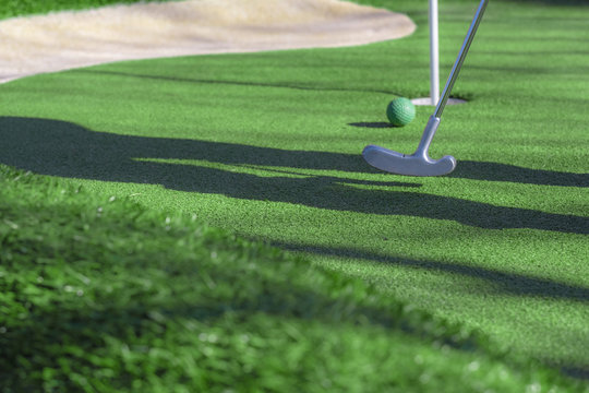 Mini golf club, ball and hole