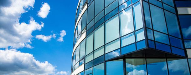 architecture exterior facade building glass windows wall design panoramic urban landmark city view on vivid blue sky white clouds background space for copy or your text Fotobehang