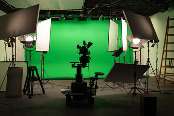 Obraz Shooting studio with professional equipment and green screen - fototapety do salonu