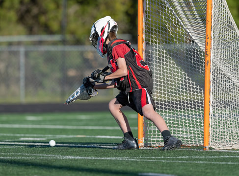 Young athletes making amazing plays while playing in a Lacrosse game
