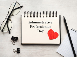 Secretaries Day and Admin Day. Greeting card. Close-up, view from above, wooden surface. Concept of preparation for a professional holiday. Congratulations for relatives, friends and colleagues. Wall mural