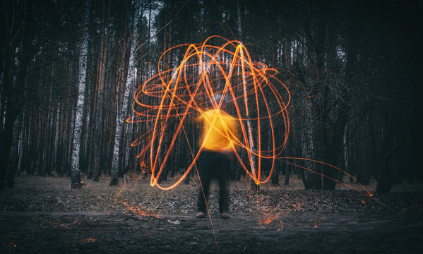Sparks from steel wool in the evening forest