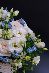 Foto op Canvas Lelie Bouquet. Composition of fresh, delicate flowers on a dark background.