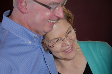 U.S. Democratic presidential candidate Senator Warren shares a moment with her husband while chatting with customers at EllaEm's Soul Food in North Las Vegas