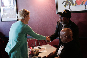 U.S. Democratic presidential candidate Senator Elizabeth Warren shakes hands with Rodney Smith at EllaEm's Soul Food in North Las Vegas