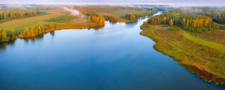 Sunset aerial atmospheric view on river in Ural Russia. Drone photography