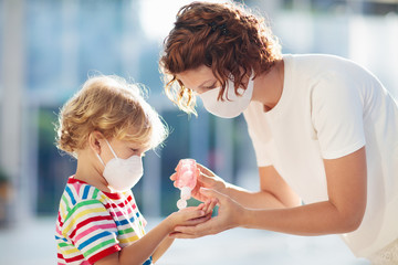 Mother and child with face mask and hand sanitizer Wall mural