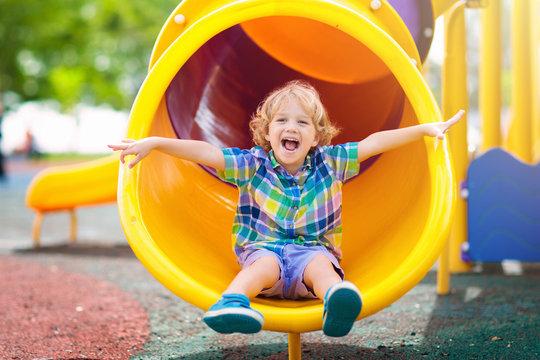 Child on playground. Kids play outdoor.