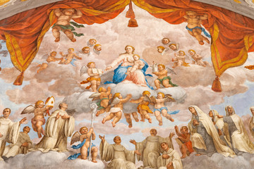 Wall Mural - FERRARA, ITALY - JANUARY 30, 2020: The fresco of Madonna among the Benedictine saints in apsida of church Basilica di San Giorgio fuori le mura by Francesco Ferrari 18. cent.