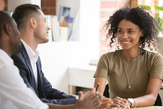 Smiling African American candidate at job interview with hr managers