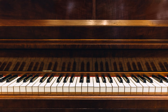 Vintage wooden piano in close-up shot