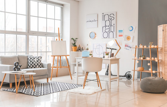 Interior of modern office with designer's workplace
