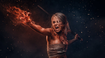 Fototapeta Fantasy woman warrior wearing rag cloth stained with blood and mud in the heat of battle. Cosplayer as Ciri from The Witcher obraz