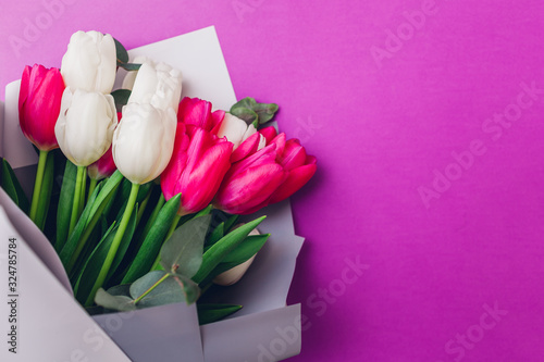 Spring flowers for international Women's day. Bouquet of white and pink tulips. Present gift for Mother's day.