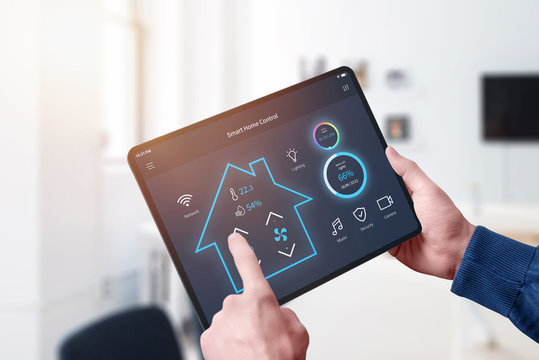 All in one smart home control system app concept on tablet display in man hands