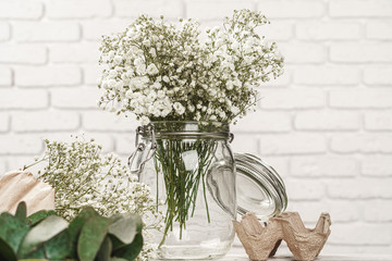 Keuken foto achterwand Bloemen Baby's-breath flowers branches in white room close up