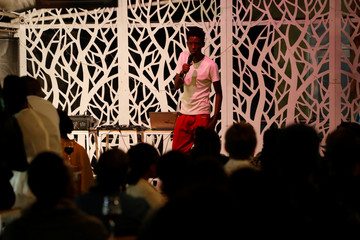 Kenyan standup comedian Brian Onjoro performs during his show at the Kez's Kitchen restaurant in Nairobi