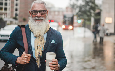 Senior business man going to work - Hipster entrepreneur drinking coffee while waiting bus - Job, leadership, fashion and confident concept - Focus on face Wall mural