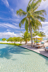 Fototapete - Summer beach vacation pool. Chaise lounge concept, luxury travel. Infinity oceanfront pool with submerged loungers in a luxury resort in Maldives, Indian Ocean
