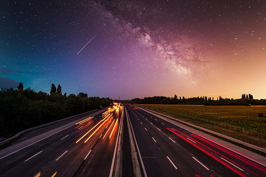 busy highway traffic on the  night full of stars
