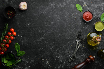 Fototapete - Black cooking background. Vegetables and spices on the table. Top view. Free space for your text.