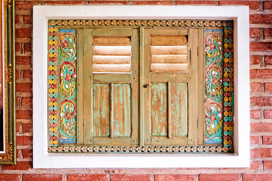 Beautiful balinese art. Colorful wooden window.