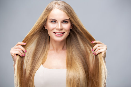 Beauty portrait of young woman with healthy skin and soft natural make up. Spa and care. Long beautiful blonde hair