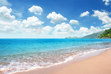 Wall Mural - Beautiful Sandy Beach with Good Weather Day and bright blue sky fully with cloudscape