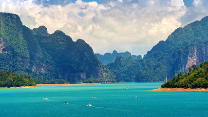 Wall Mural - Beautiful mountains in Ratchaprapha Dam at Khao Sok National Park, Surat Thani Province, Thailand.
