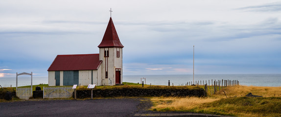 Historical Chapel overseeing the vast ocean on a peaceful afternoon in Snæfellsnes  Peninsular, Iceland
