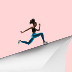 Imagine who's covering white sheet to get digital file icon. Young woman, professional runner runs up the edge of huge paper sheet. Digital world, funny imagination of the way the shout appearing.