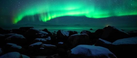 Stores à enrouleur Aurore polaire Night green aurora from stone coast , polar shine/light