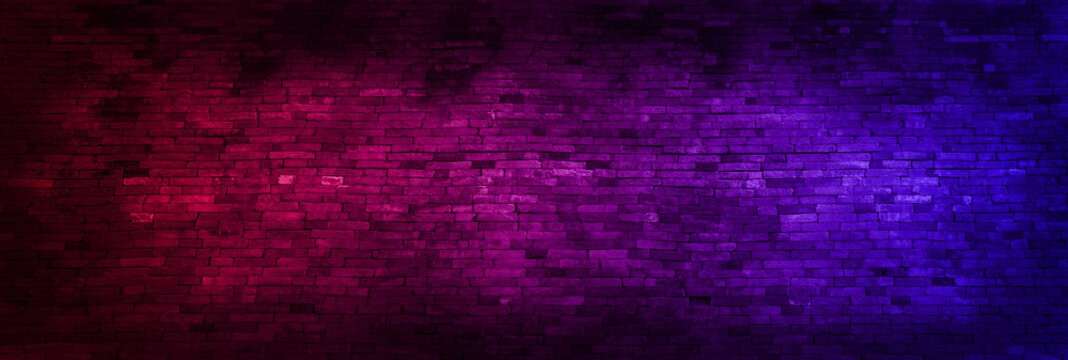 Panorama Neon light on brick walls that are not plastered background and texture. Lighting effect red and blue neon background of empty brick basement wall.