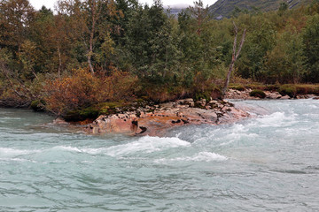 Keuken foto achterwand Noordzee Glacial emerald river in autumn Norway landscape