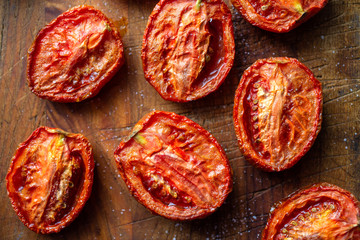 Close up of roasted tomatoes on cutting board