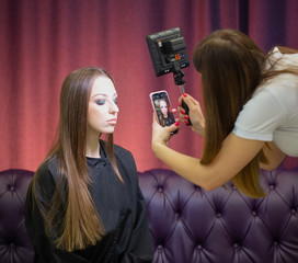 Makeup artist take pictures of the model after their work