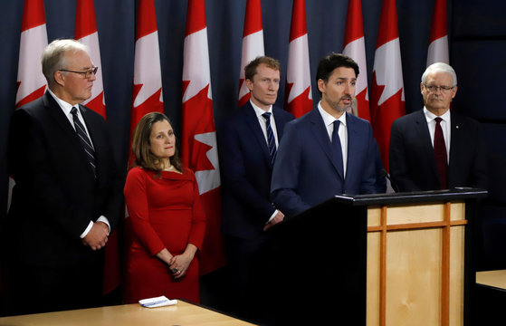 Canada's Prime Minister Trudeau speaks to news media along with cabinet members, left to right, Minister of Public Safety and Emergency Preparedness Blair, Deputy Prime Minister Freeland, Indigenous Services Minister Miller, and Minister of Transport Garne